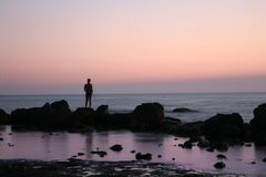 Fishing at sunset sea Royalty Free Stock Photography