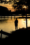 Fishing sunset silhouette Royalty Free Stock Photos