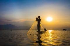 Fishing at sunset. Throwing fishing in kwan phayao Thailand Stock Photos