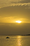 Fishing at sunset under beams and reflections of yellow light, Sithonia Royalty Free Stock Photography