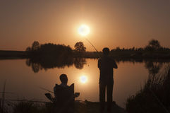 Fishing at sunset. Warm summer day Stock Images