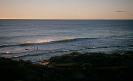 Fishing in the surf. Fishermen at sunset near Kalbarri, Western Australia Royalty Free Stock Image