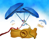 Fishing symbol on wooden board and three blue umbrella in background binded using colorful ropes Royalty Free Stock Photography