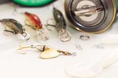 Fishing tackle. A fishing lures and reel. selective focus Stock Images