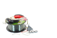 Fishing tackle. Fishing line with lures sinkers and hooks isolated on white Royalty Free Stock Photo