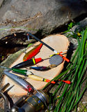 Fishing tackle against the backdrop of stone Royalty Free Stock Photos