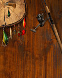 Fishing Tackle Background. Wooden background with fishing tackle and knife Royalty Free Stock Photos