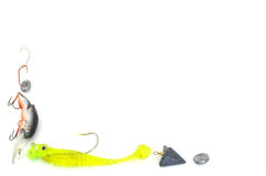 Fishing tackle border. Fishing tackle variety as border bottom left corner isolated on white Stock Photography