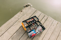 With a fishing tackle box Stock Photography