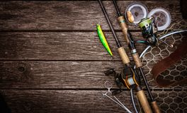 Fishing tackle composition, wood background. royalty free stock photography