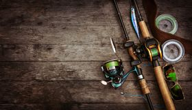 Fishing tackle composition, wood background. Royalty Free Stock Photo