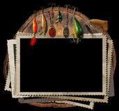Fishing Tackle and Empty Photo Frames. Empty, old and vintage photo frames and artificial fishing baits with folding knife. On a tree trunk and Isolated on a Royalty Free Stock Photography