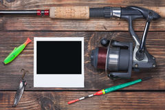 Fishing tackle and photoframe Stock Images