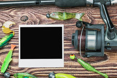 Fishing tackle and photoframe Royalty Free Stock Image