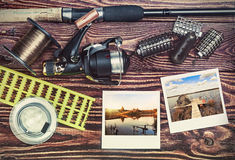 Fishing tackle and photoframe Royalty Free Stock Photo