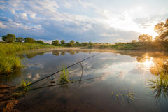 Fishing tackle in a pond Stock Photography