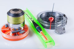 Fishing tackle - reel, floats, boxes. On a white background, not  Royalty Free Stock Photo