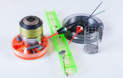 Fishing tackle - reel, floats, boxes. On a white background, not isolated Stock Photo