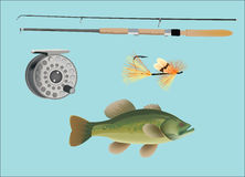 Fishing tackle. Rod with eddies and sea bass Royalty Free Stock Photo