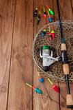Fishing tackle - fishing rod fishing float and lures on beautiful blue wooden background, copy space.  royalty free stock photos