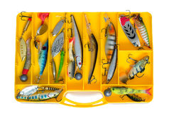 Fishing tackle: a set of spoons in the container. Stock Images