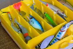 Fishing tackle: a set of spoons in the container. royalty free stock image