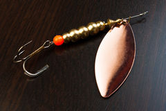 Fishing Tackle. Spinner with a triple hook for fishing Stock Photos
