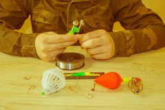 Fishing tackle - fishing spinning, fishing line, hooks and lures on the table royalty free stock photos