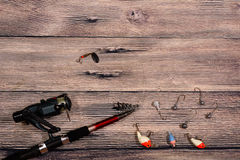 Fishing tackle - spinning, line, hooks and lures Royalty Free Stock Photography