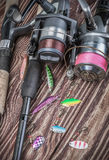 Fishing tackle spinning on a wooden table Royalty Free Stock Photo