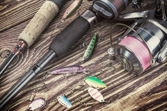 Fishing tackle spinning on a wooden table Stock Images