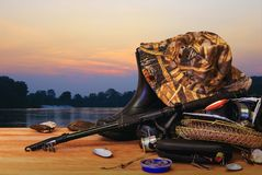 Fishing tackle and sunset Stock Photos