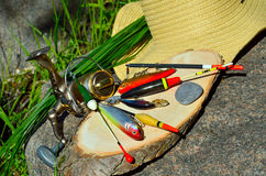 Fishing tackle with wicker basket and hat Stock Image
