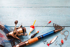 Fishing tackle on wooden blue background Royalty Free Stock Image