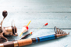 Fishing tackle on wooden blue background Stock Image