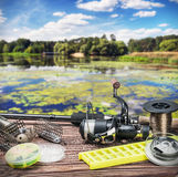 Fishing tackle on a wooden float on a background of forest lake Royalty Free Stock Photos