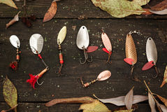 Fishing tackle on wooden surface. Royalty Free Stock Photo
