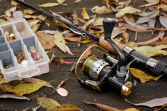 Fishing tackle on wooden surface. Stock Photo
