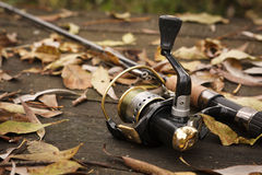 Fishing tackle on wooden surface. Royalty Free Stock Image