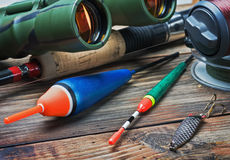 Fishing tackle on a wooden table Royalty Free Stock Photo