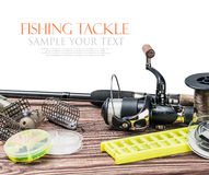 Fishing tackle on a wooden table isolated on a white Stock Photography