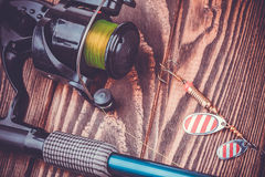 Fishing tackle on a wooden table Royalty Free Stock Photos