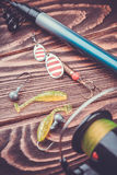 Fishing tackle on a wooden table Stock Image