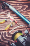 Fishing tackle on a wooden table Stock Images