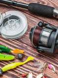 Fishing tackle on a wooden table Stock Photo