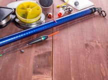 Fishing tackle on a wooden table royalty free stock image