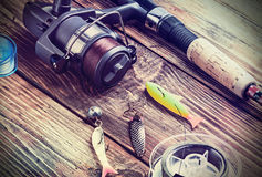 Fishing tackle on a wooden table Stock Photos