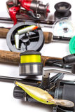 Fishing tackles and baits with rods and reels royalty free stock image