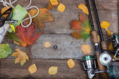 Fishing tackles on board with leafs autumn Stock Photo