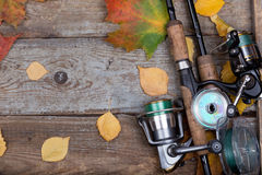 Fishing tackles on board with leafs autumn Stock Image
